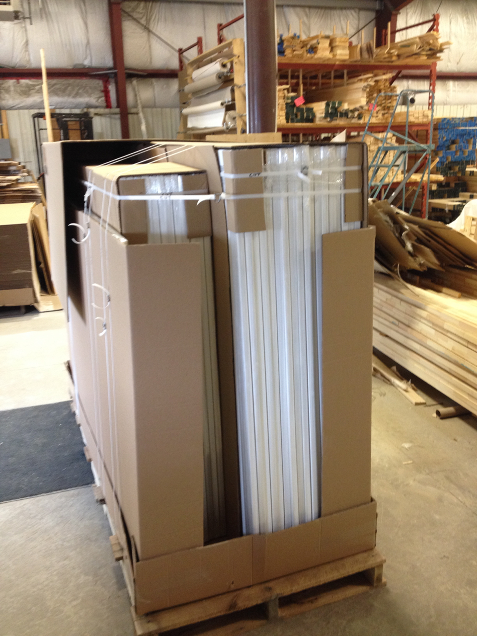 36 blank canvases being packaged for shipping to Brooklyn, NY