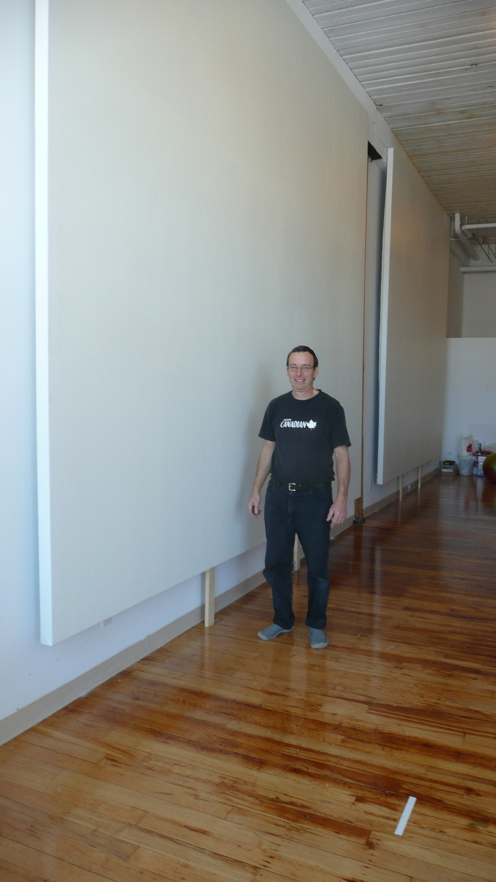 Several large 12' x 15' blank canvases stretched and installed in a Montreal studio.
