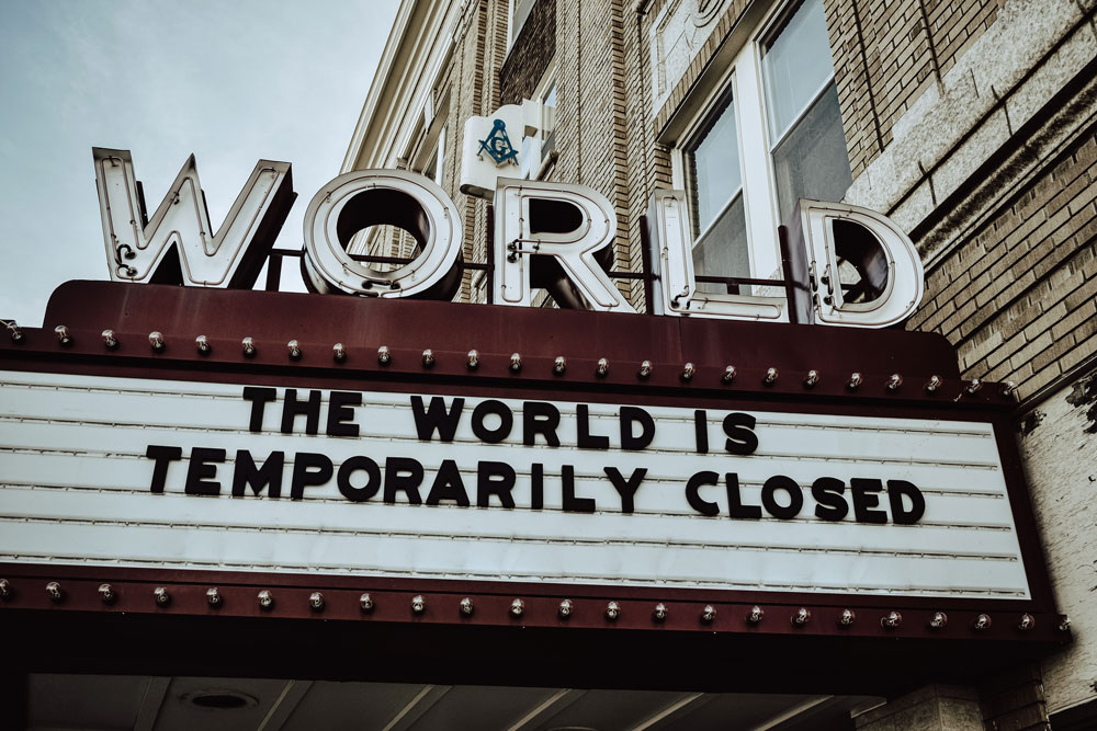 'The World is Temporarily Closed' sign - Photo by Edwin Hooper on Unsplash